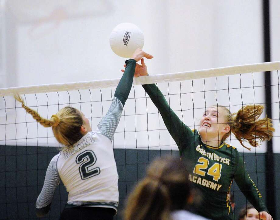 Sacred Heart's Kellie Ulmer (#2), left, and Greenwich Academy's Kate Miele (#24) meet above the net as they went for the ball during the girls high school volleyball match between crosstown rivals, Sacred Heart Greenwich and Greenwich Academy at Sacred Heart in Greenwich, Conn., Oct. 11, 2018. Photo: Bob Luckey Jr. / Hearst Connecticut Media / Greenwich Time
