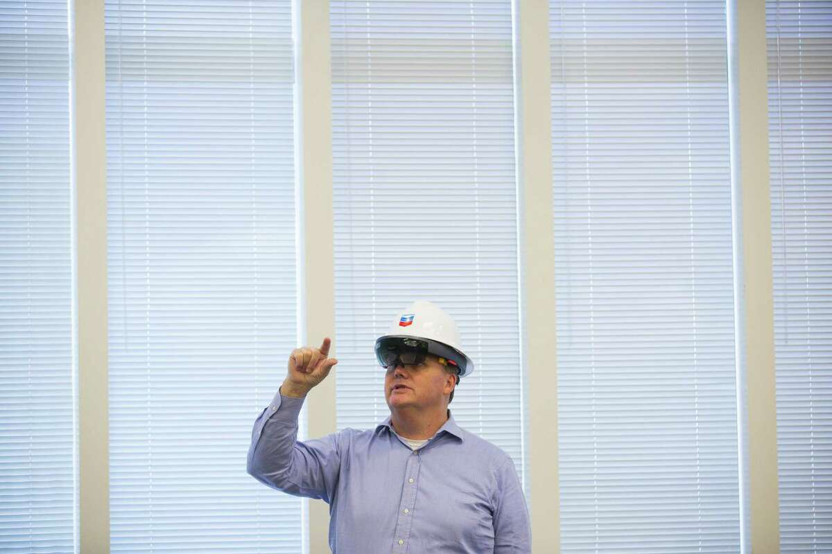 Ed Moore, who manages IIoT (Industrial Internet of Things) technology for Chevron, demonstrates how the company is starting to use augmented reality technology through the Microsoft HoloLens, Monday, Oct. 1, 2018 in downtown Houston.