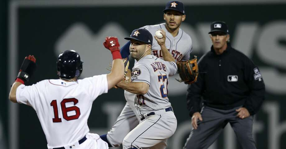 Boston Red Sox's Andrew Benintendi (16) is forced out at second base as Houston Astros' Jose Altuve (27) turns the double play on J.D. Martinez during the ninth inning of a baseball game in Boston, Saturday, Sept. 8, 2018. (AP Photo/Michael Dwyer) Photo: Michael Dwyer/Associated Press