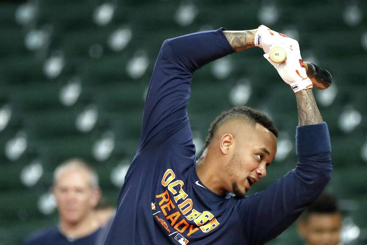 Houston Astros catcher Martin Maldonado watms up to hit during batting practice at Minute Maid Park, October 4, 2018, in Houston.