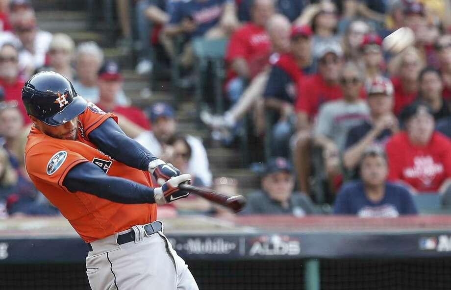 Houston Astros outfielder George Springer hits a solo home run against the Cleveland Indians during the eighth inning of Game 3 of the American League Division Series at Progressive Field on Monday, Oct. 8, 2018, in Cleveland. Photo: Karen Warren, Houston Chronicle / Staff Photographer / © 2018 Houston Chronicle
