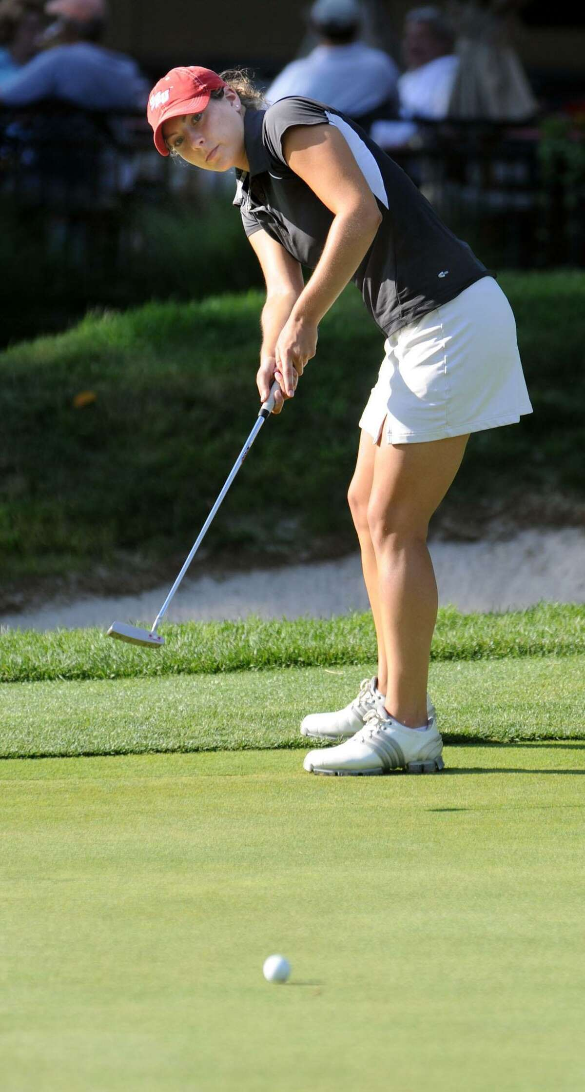 Jen Tierney putts on the 18th hole Sunday during the Danbury Amateur golf championship at Richter Park, July 18, 2010.