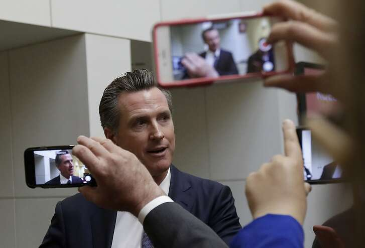 Democratic candidate Gavin Newsom speaks with reporters after a California gubernatorial debate with Republican candidate John Cox at KQED Public Radio Studio in San Francisco, Monday, Oct. 8, 2018. (AP Photo/Jeff Chiu, Pool)