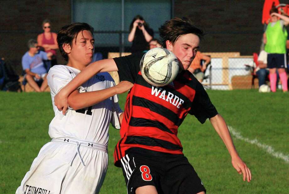 Fairfield Warde's Cole Jennings heads the ball during boys high school soccer action against Trumbull in Fairfield, Conn., on Wednesday Oct. 10, 2018. At left is Trumbull's Nicola Milovanov. Photo: Christian Abraham / Hearst Connecticut Media / Connecticut Post