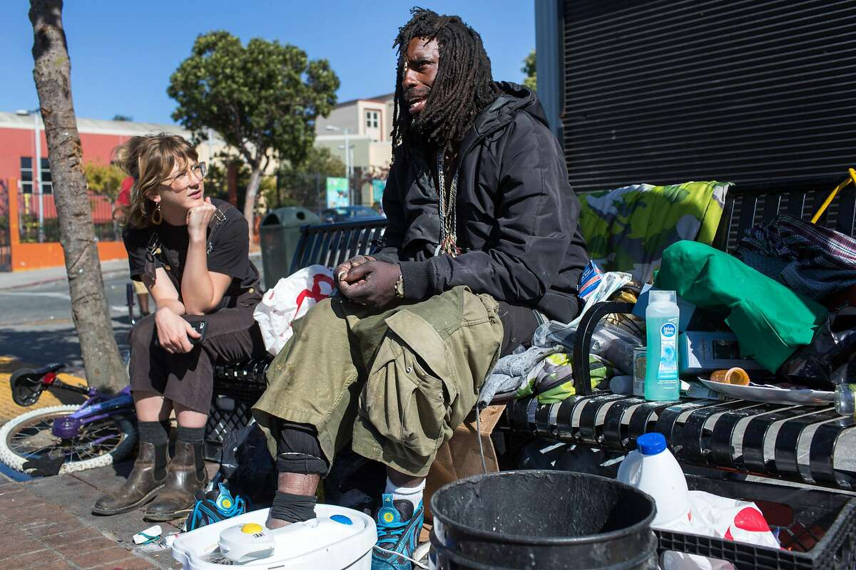 Kiefer Cropper, outreach specialist from the Homeless Outreach Team, talks to Onnie P. Broussard, 37. Broussard grew up in the Bay View and has been on the street for almost 2 years. Bay View on Monday, September 24, 2018 in San Francisco Calif.