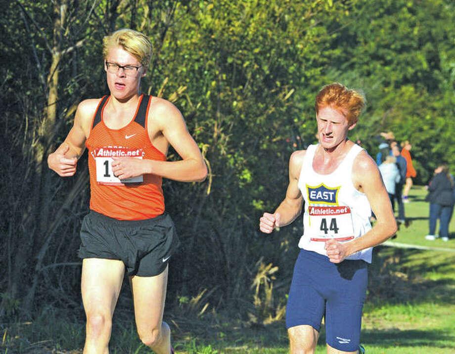 Edwardsville junior Henry Gruben, left, runs in Thursday's Southwestern Conference Meet at Belleville West. Photo: Scott Marion/Intelligencer