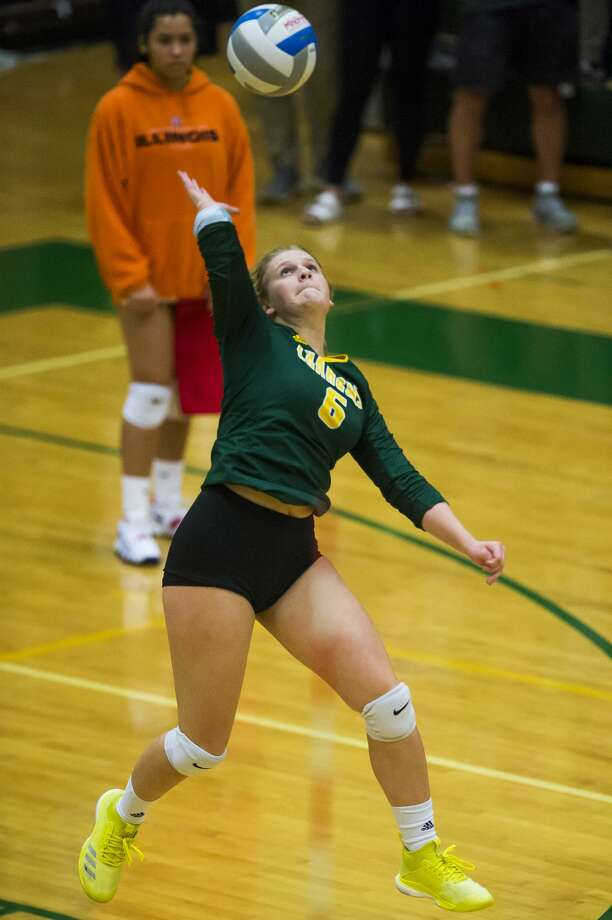 Dow junior Jenna Somers spikes the ball during a match against Clio on Thursday, Oct. 11, 2018 at H. H. Dow High School. (Katy Kildee/kkildee@mdn.net) Photo: (Katy Kildee/kkildee@mdn.net)