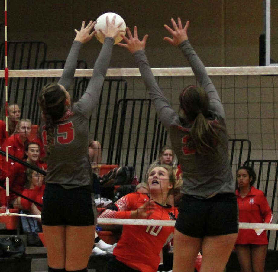 Alton's Brooke Wolff (left) goes up with teammate Abbigail Powers to block the attack from Edwardsville's Emma Garner in Thursday's SWC volleyball match in Edwardsville. Photo: Alton's Brooke Wolff (left) Goes Up With Teammate Abbigail Powers To Block The Attack From Edwardsville's Emma Garner In Thursday's SWC Volleyball Match In Edwardsville. Alton's Janelle Rose (right) Hits In The Block Of Edwardsville's Morgan Tulacro In Thursday's SWC Volleyball Match In Edwardsville. Alton's Shiann Johnson (3) Hits Into The Block Of Edwardsville's Alexa Harris (6) And Corrine Timmerman In Thursday's SWC Volleyball Match In Edwardsville. Alton's Sammi Dosso Receives A Serve In Thursday's SWC Volleyball Match In Edwardsville. Alton's Grace Kane Backs Up To Make A Pass Of A Serve In Thursday's SWC Volleyball Match In Edwardsville. Edwardsville's Lexie Curtis (left) And Emma Garner Celebrate A Point In Thursday's SWC Volleyball Match In Edwardsville. Edwardsville's Emma Gardner His Crosscourt In Thursday's SWC Volleyball Match In Edwardsville. Edwardsville's Alexa Harris Sends The Ball Over The Net In Thursday's SWC Volleyball Match In Edwardsville. Edwardsville's Corrine Timmermann Attacks Before Alton's Janelle Rose And Leilani Hill Can Rise Up For A Block In Thursday's SWC Volleyball Match In Edwardsville. Edwardsville's Alexa Harris Receives A Serve While Teammates Rhianna Huebner (2) And Jillian Allen Back Up The Play In Thursday's SWC Volleyball Match In Edwardsville.