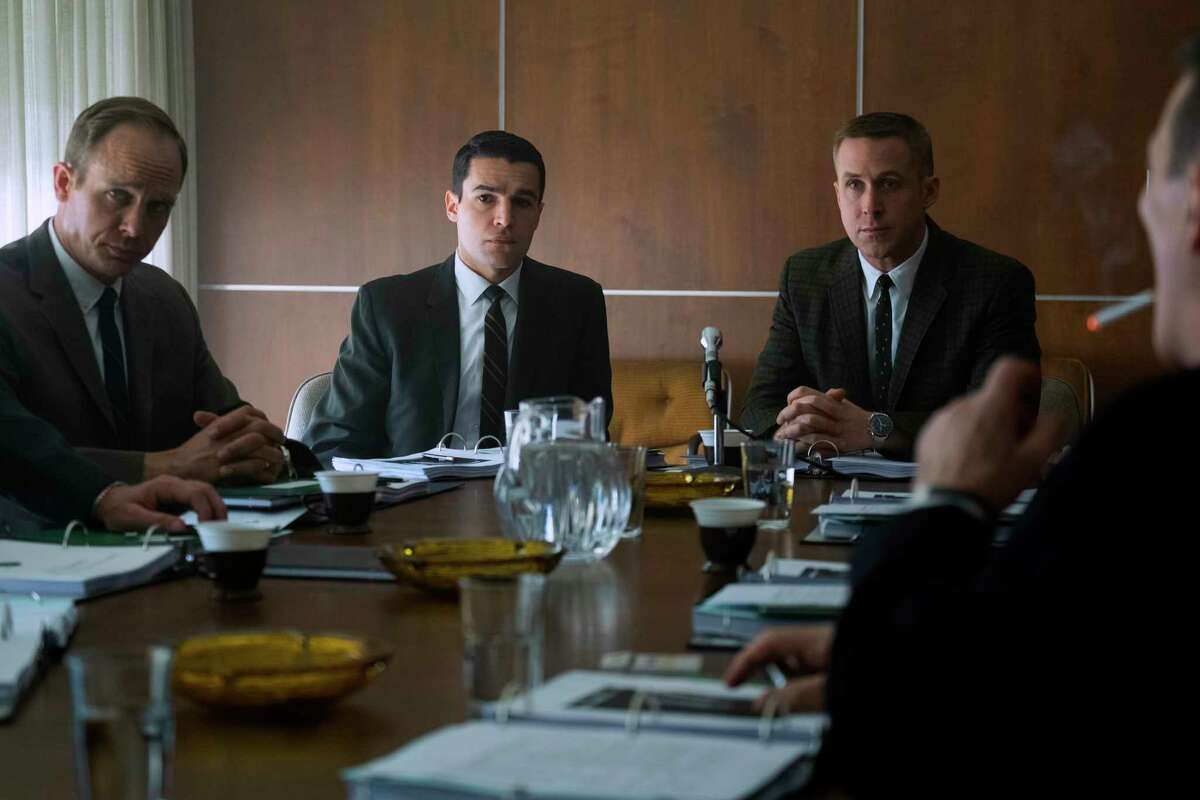 """This image released by Universal Pictures shows Ethan Embry, from left, Christopher Abbot and Ryan Gosling in a scene from """"First Man."""" (Daniel McFadden/Universal Pictures via AP)"""