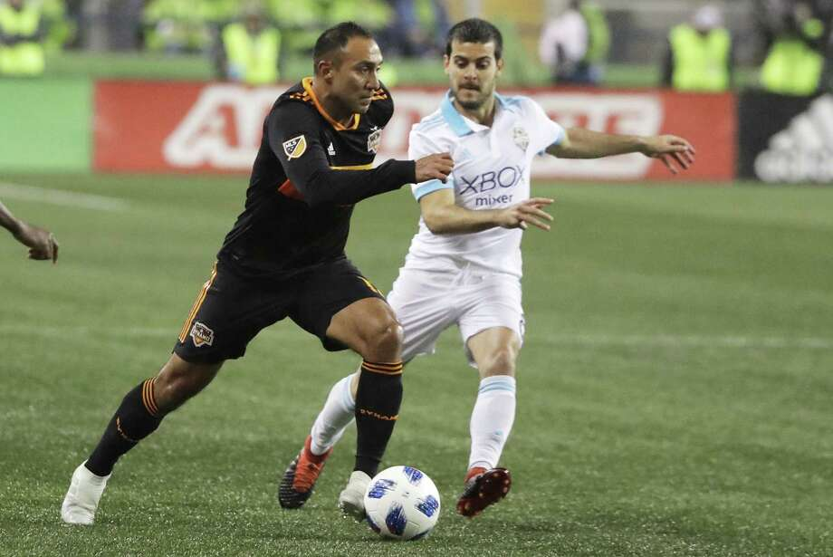 Dynamo forward Arturo Alvarez, left, drives past Seattle Sounders midfielder Victor Rodriguez, right, during the first half of the Dynamo's 4-1 loss Oct. 8 in Seattle. Photo: Ted S. Warren, STF / Associated Press / Copyright 2018 The Associated Press. All rights reserved.