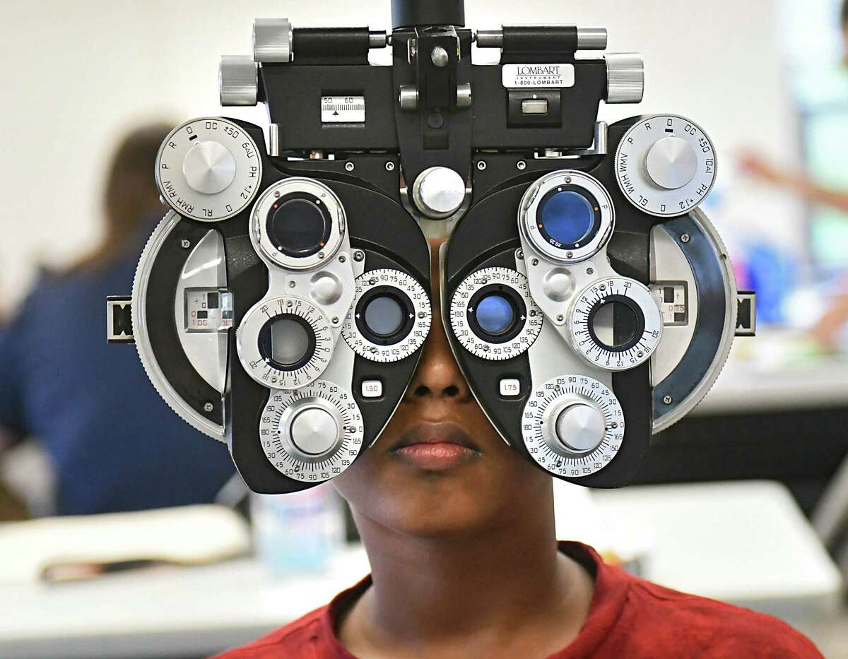 Fifth grader Randy Persaud, 10, gets a free eye exam at Keane Elementary School on Thursday, Oct. 11, 2018 in Schenectady, N.Y. New York State Education Department, the New York State Optometric Association (NYSOA), VSP Global, and the New York State Society of Opticians (NYSSO offered students to receive comprehensive no-cost vision exams and eyeglasses. (Lori Van Buren/Times Union)