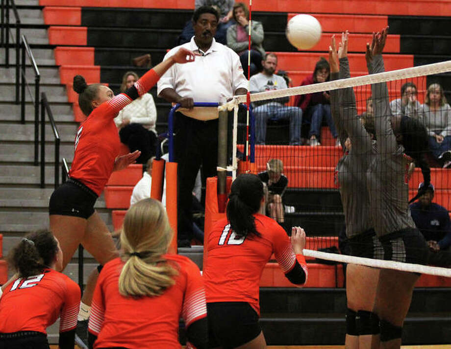 Edwardsville's Alexa Harris gets a kill through a double block put up by the Redbirds during the Tigers' 25-7, 25-10 Southwestern Conference victory Thursday night at Lucco-Jackson Gym in Edwardsville. Photo: Greg Shashack / The Telegraph
