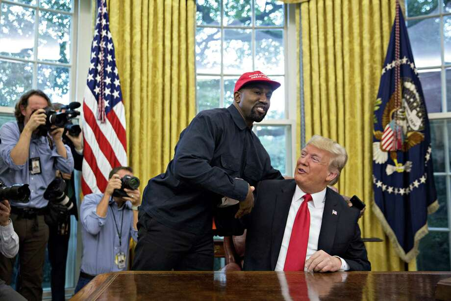 Rapper Kanye West, left, shakes hands with U.S. President Donald Trump during a meeting in the Oval Office of the White House in Washington, D.C., U.S., on Thursday, Oct. 11, 2018. West, a recording artist and prominent Trump supporter, is at the White House to have lunch with the president and to meet with presidential son-in-law and senior adviser Jared Kushner who has spearheaded the administrations efforts overhaul the criminal justice system. Photographer: Andrew Harrer/Bloomberg Photo: Andrew Harrer / © 2018 Bloomberg Finance LP