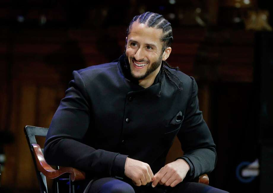 Former NFL football quarterback Colin Kaepernick is seated on stage during W.E.B. Du Bois Medal ceremonies, Thursday, Oct. 11, 2018, at Harvard University, in Cambridge, Mass. Kaepernick is among eight recipients of Harvard University's W.E.B. Du Bois Medals in 2018. Harvard has awarded the medal since 2000 to people whose work has contributed to African and African-American culture. (AP Photo/Steven Senne) Photo: Steven Senne / Copyright 2018 The Associated Press. All rights reserved