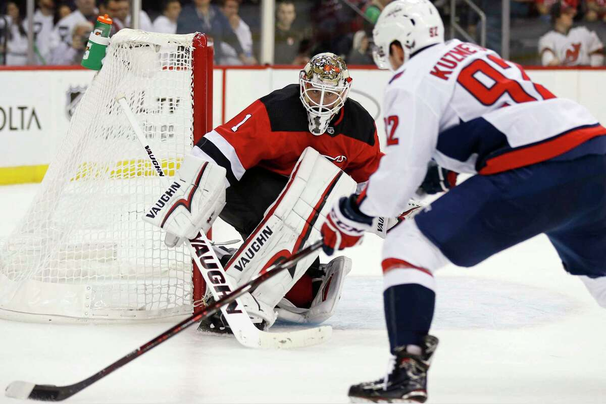 New Jersey Devils goaltender Keith Kinkaid (1) defends against Washington Capitals center Evgeny Kuznetsov (92) during the third period of an NHL hockey game Thursday, Oct. 11, 2018, in Newark, N.J. The Devils won 6-0. (AP Photo/Adam Hunger)