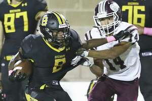 Darryon Tolefree twists away from Noah Muniz in the second quarter as Brennan plays Marshall at Farris Stadium on October 11, 2018.