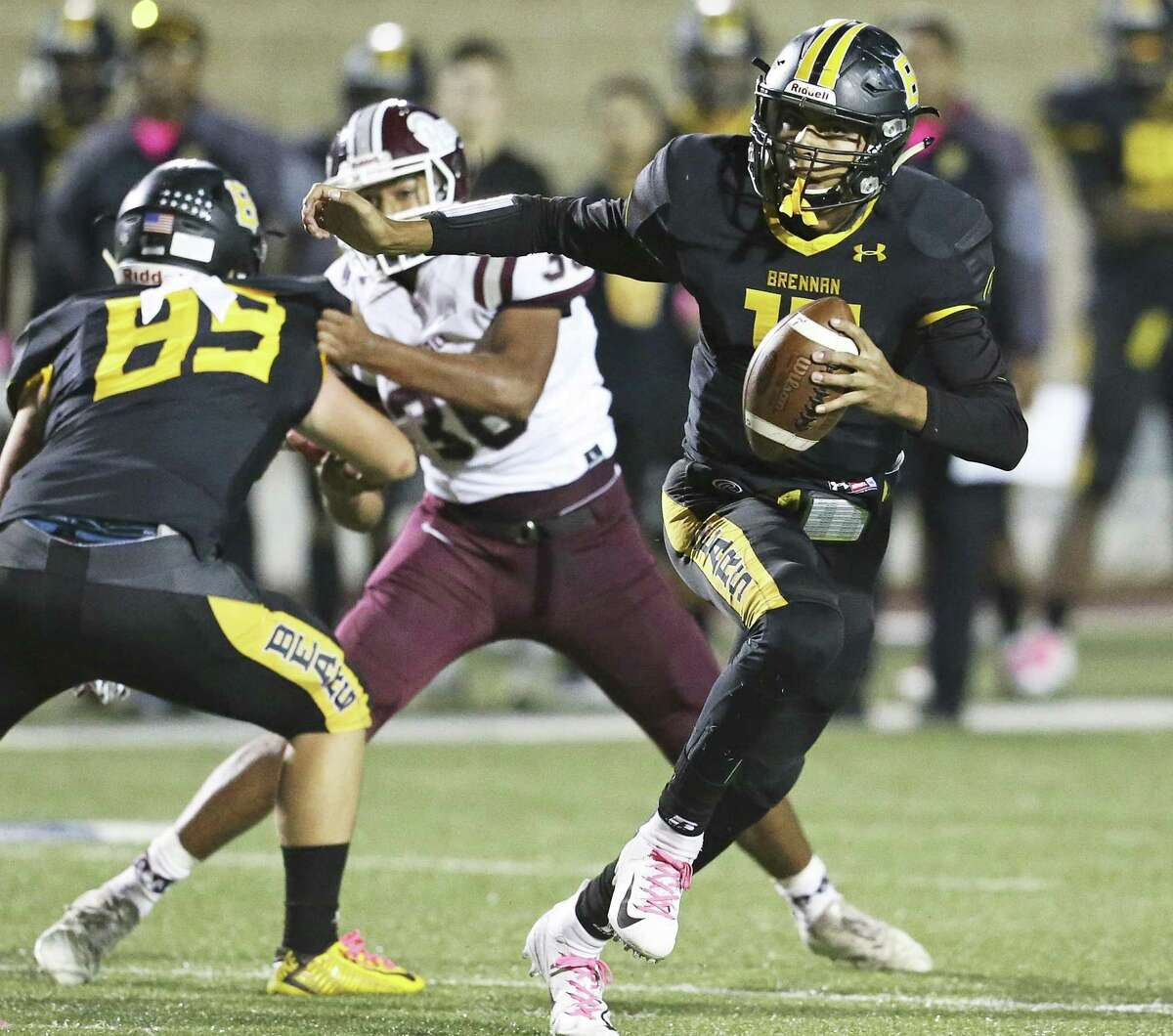 Bears quarterback Jordan Flores escapes the backfield to his left as Brennan plays Marshall at Farris Stadium on October 11, 2018.