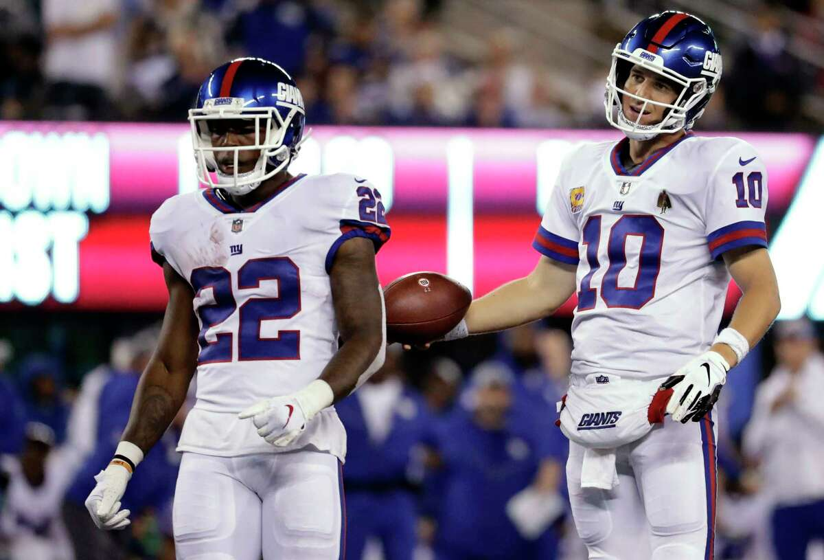 New York Giants quarterback Eli Manning (10) and teammate Wayne Gallman (22) react to a false-start call during the first half of an NFL football game against the Philadelphia Eagles on Thursday, Oct. 11, 2018, in East Rutherford, N.J. (AP Photo/Julio Cortez)