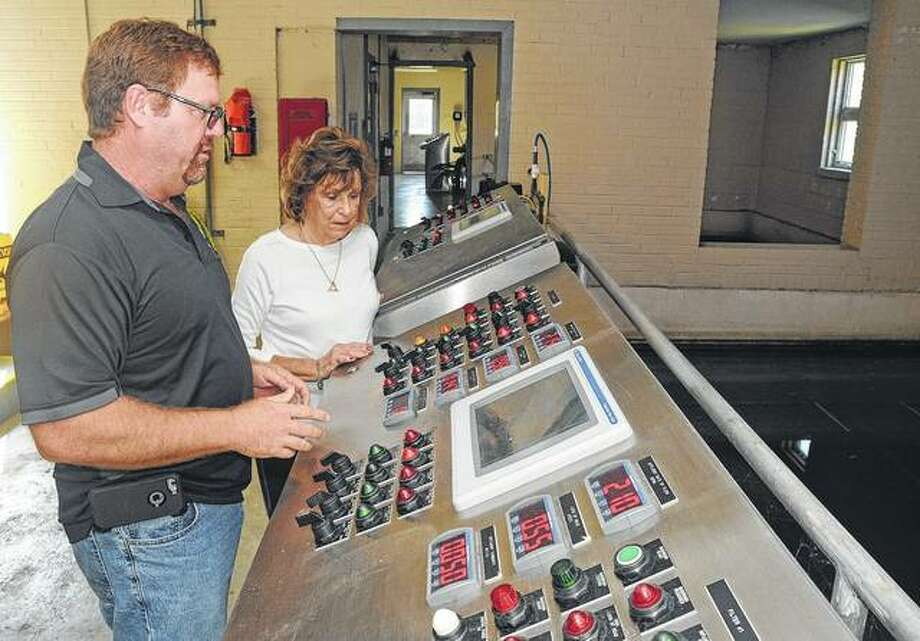 Carlinville public works director Dan Held shows Mayor Deanna Demuzio some of the control equipment inside the city's water plant. Photo: David Blanchette | Journal-Courier