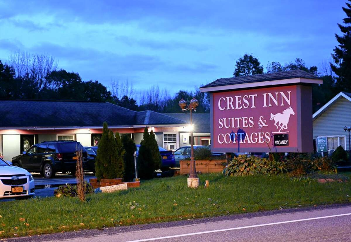 State Police remained at the scene Friday morning of what they say is a suspicious death at the Crest Inn and Suites, a motel on Route 9 in Wilton that is owned by Shahed Hussain, the owner of a limousine that crashed in Schoharie Saturday, killing the driver and 17 passengers.