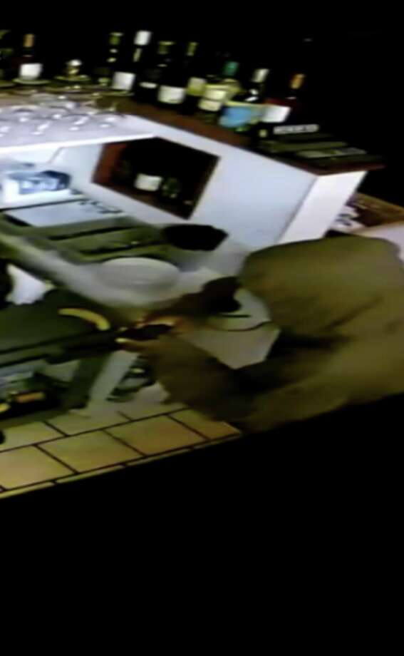 An armed man held up the the Taste of Thai restaurant on Broad Street in Armory Square in Milford on Wednesday, Oct. 10, 2018.  The man is also a suspect in the robbery of a man at a People's Bank drive-thru two nights earlier. Photo: Milford Police