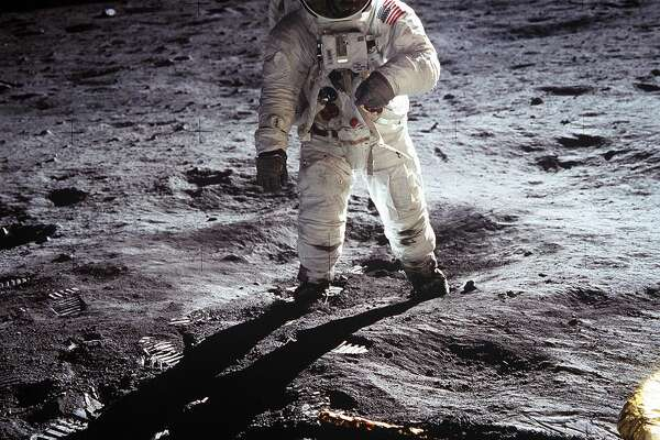 "This image of Buzz Aldrin on the surface of the moon is one of the most iconic in all of Apollo 11's archives -- and NASA's history. Aldrin walked on the moon on July 20, 1969 with crewmate Neil Armstrong. In the image, footprints fill the lunar soil to the left and the leg of the Lunar Module ""Eagle"" can be seen in the bottom right quadrant. Of course, the man in the helmet's reflection is Neil Armstrong."