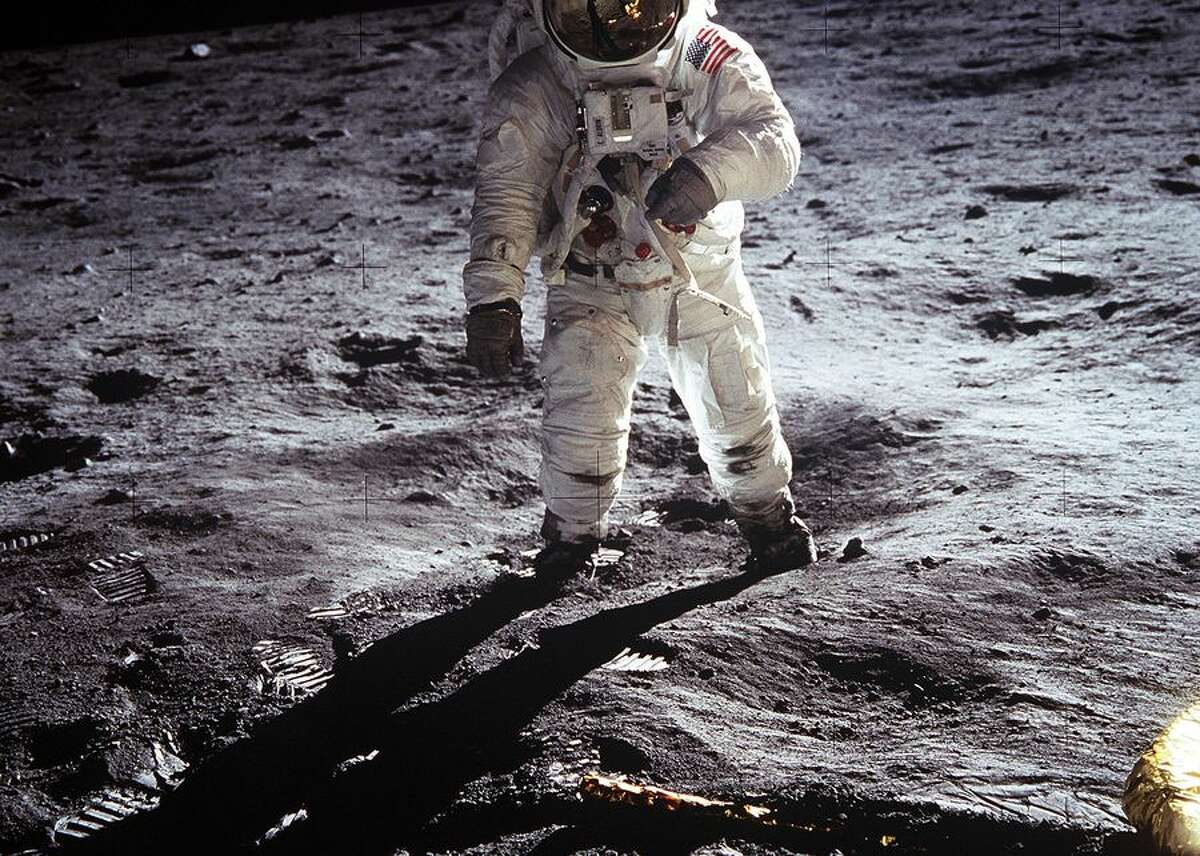 """This image of Buzz Aldrin on the surface of the moon is one of the most iconic in all of Apollo 11's archives -- and NASA's history. Aldrin walked on the moon on July 20, 1969 with crewmate Neil Armstrong. In the image, footprints fill the lunar soil to the left and the leg of the Lunar Module """"Eagle"""" can be seen in the bottom right quadrant."""