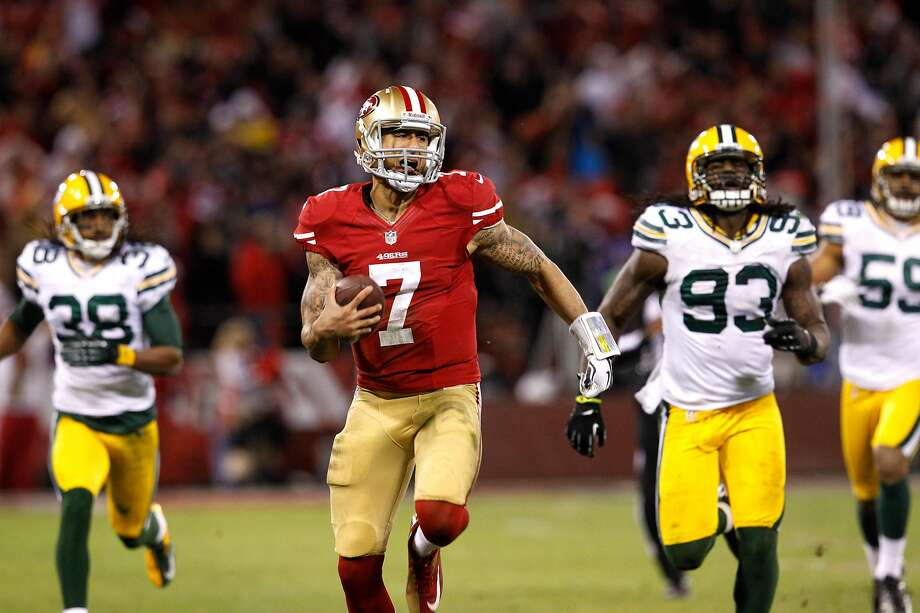 San Francisco 49ers Quarterback Colin Kaepernick (7) runs in for a touchdown in the third quarter of the San Francisco 49ers game against the Green Bay Packers in the NFC Divisional Playoffs at Candlestick Park in San Francisco, Calif., on Saturday January 12, 2013. Photo: Brant Ward / The Chronicle