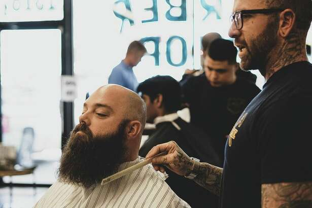 East End Barber owner Ryan Taylor tends to the beard needs of a shop customer that is not the author of this story.