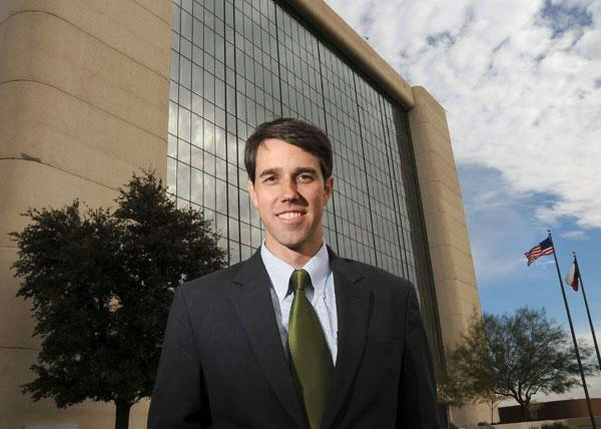 Beto O'Rourke while a member of city council poses for a photo outside the former City Hall building in El Paso.