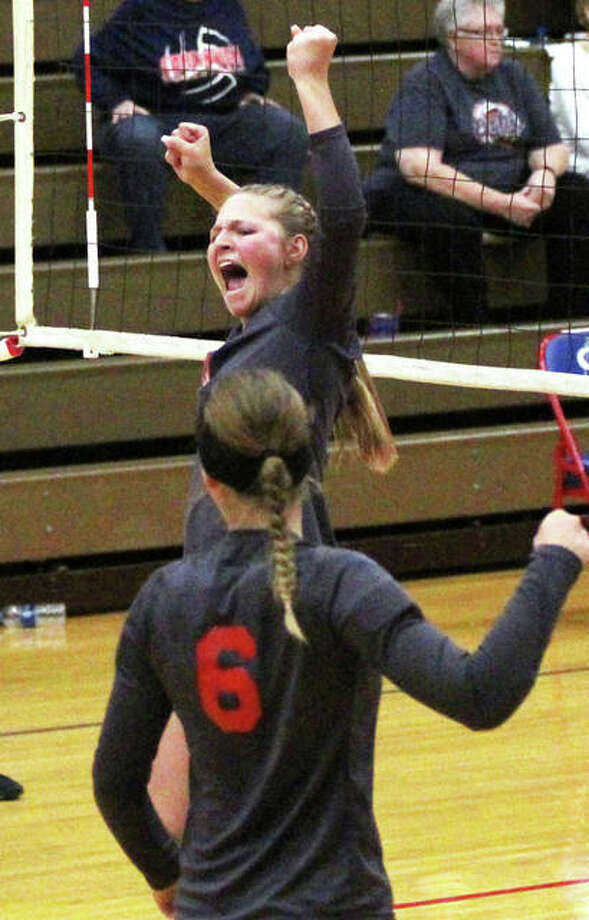 Staunton's Taryn Russels (back) celebrates a point with teammate Sarah Isenberg in the third set of the Bulldogs' victory over Carlinville in the championship match of the Macoupin County Tournament on Saturday in Carlinville. Staunton extended its winning streak to eight in a row Thursday with a key SCC victory at home over Greenville. Photo: Greg Shashack / The Telegraph