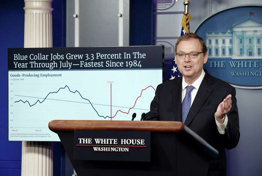Kevin Hassett, chairman of the White House's Council of Economic Advisers, addresses questions about federal deficit. While the recent tax cuts have fueled the economy, they also make it certain the Fed will continue its campaign of boosting interest rates, They also will help swell the national debt by almost $3.8 trillion, over the next two decades, according to the Tax Policy Institute. Photo: Olivier Douliery, FILE / TNS / Abaca Press
