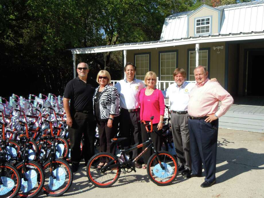The Champions Sunrise Rotary Club prepares to distribute bicycles to 38 schools in Klein, Cy-Fair and Spring, as part of their Pedaling for Success program that aims to encourage elementary school students to strive for success in school. Photo: Courtesy Of Champions Sunrise Rotary / Courtesy Of Champions Sunrise Rotary