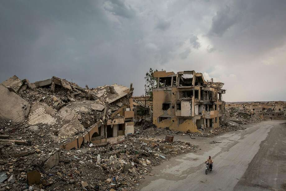 Rubble from buildings line a street in June that was decimated during fighting between U.S.-backed forces and the Islamic State in Raqqa, once a stronghold of the militants in Syria. Photo: Ivor Prickett / New York Times