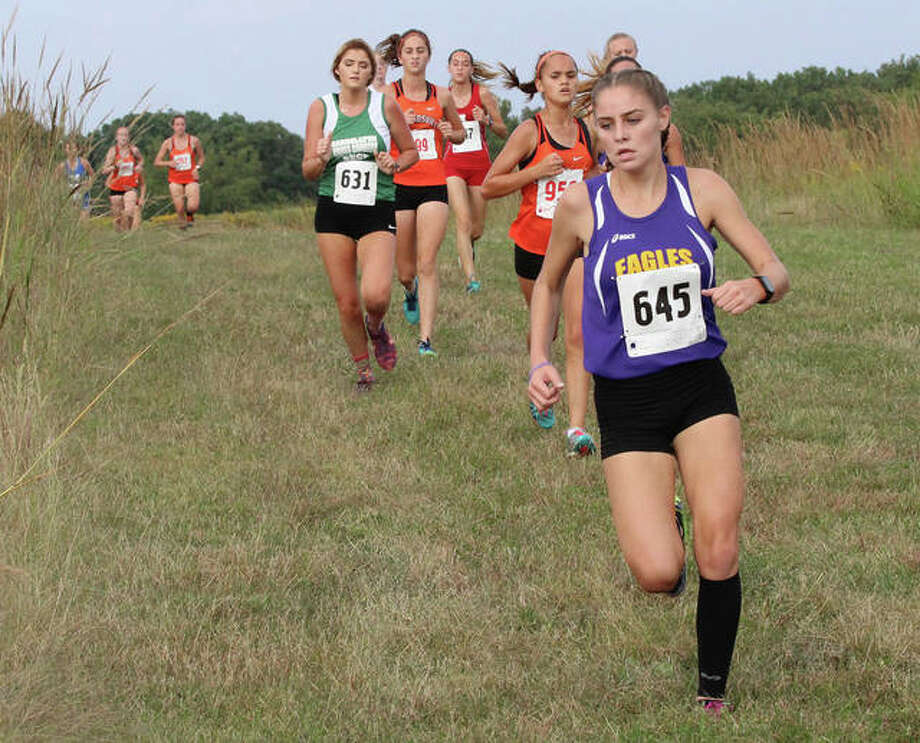 CM's Zoey Lewis, shown leading a pack of runners into a turn at Jersey's Havens Invite on Sept. 24 in Elsah, was back on the Principia College cross country course Thursday for the Mississippi Valley Conference Meet. Lewis led the Eagles with a 13th place finish. Photo: Greg Shashack / The Telegraph