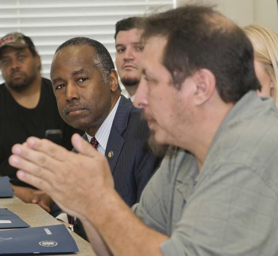 HUD Secretary Ben Carson listens as veteran Edward Cano speaks 10/12/18 about his experience utilizing housing vouchers and veteran services during a roundtable discussion with Carson, other area veterans and members of the Midland Housing Authority. Tim Fischer/Reporter-Telegram Photo: Tim Fischer/Midland Reporter-Telegram
