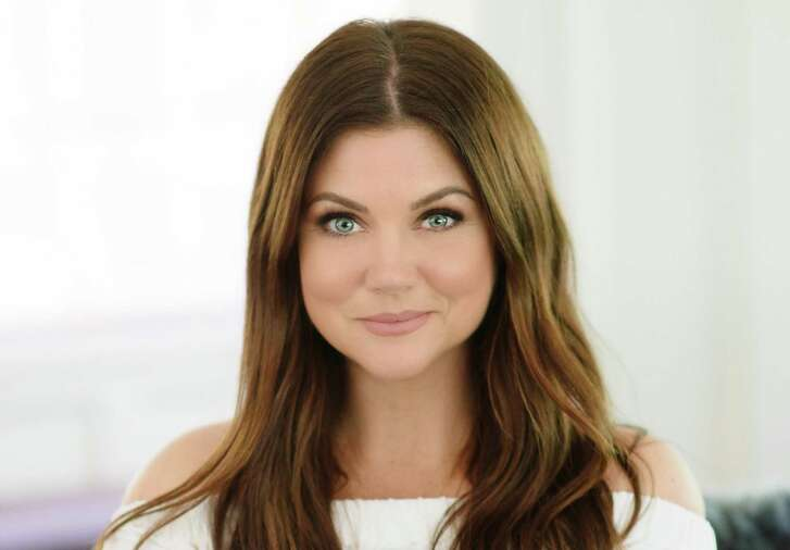 """Actress Tiffani Thiessen, the host of Cooking Channel's """"Dinner at Tiffani's,"""" has published her first cookbook, """"Pull Up a Chair."""""""