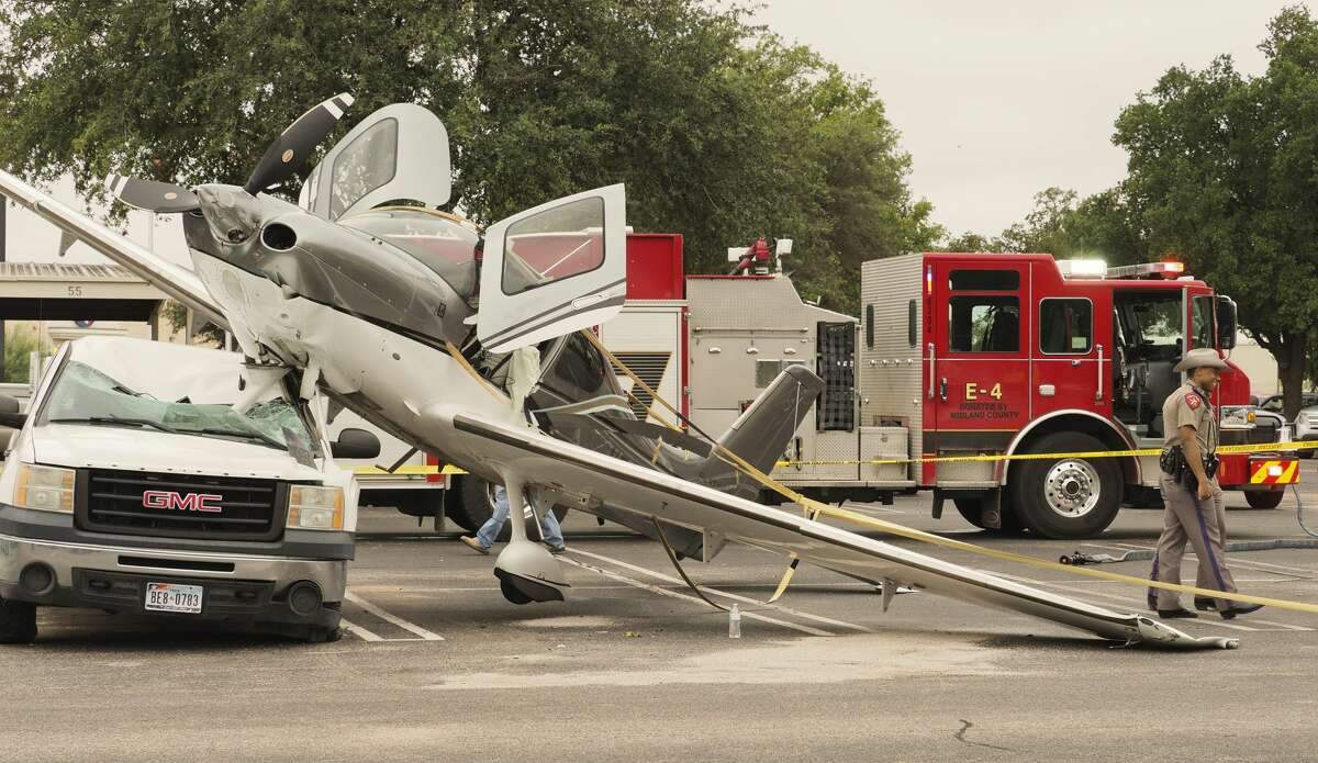 The pilot and passenger were able to walk away from a small plane that crash landed in the north parking lot of Clay Desta 10/12/18 morning. Tim Fischer/Reporter-Telegram
