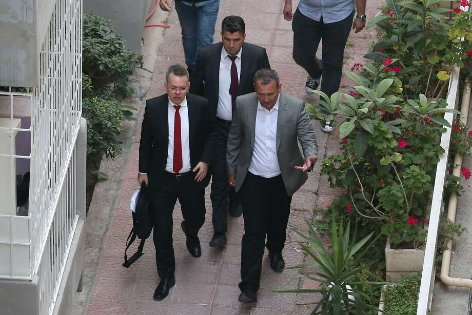 U.S. pastor Andrew Brunson (left) is escorted to his home following a trial in western Izmir province. Photo: AFP / Getty Images