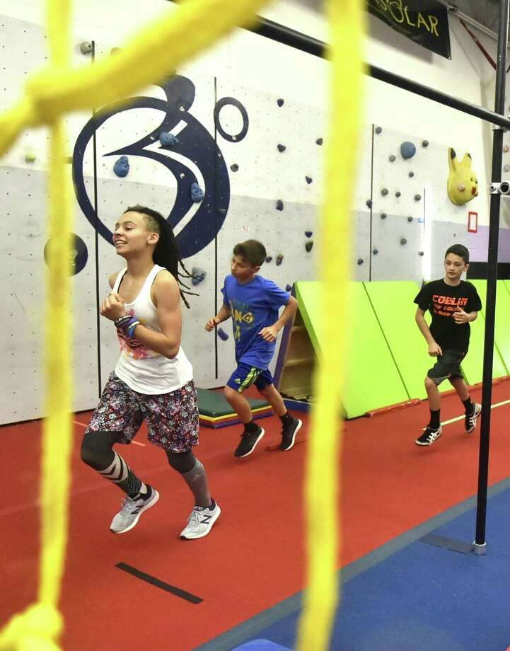 From left, Peace Lopez, 14, of Wallingford, Kody Hazan, 13, of Hamden, and Collin Cella, 10, of Milfordgo through their workout Wednesday at New Era Ninjas gym in Hamden. Photo: Peter Hvizdak / Hearst Connecticut Media / New Haven Register