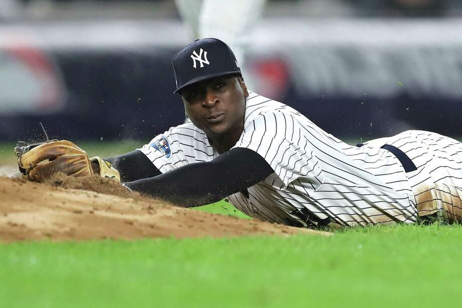 NEW YORK, NEW YORK - OCTOBER 08:   Didi Gregorius #18 of the New York Yankees falls to the ground after fielding a ball against the Boston Red Sox during the fourth inning in Game Three of the American League Division Series at Yankee Stadium on October 08, 2018 in the Bronx borough of New York City. Photo: Getty Images / 2018 Getty Images