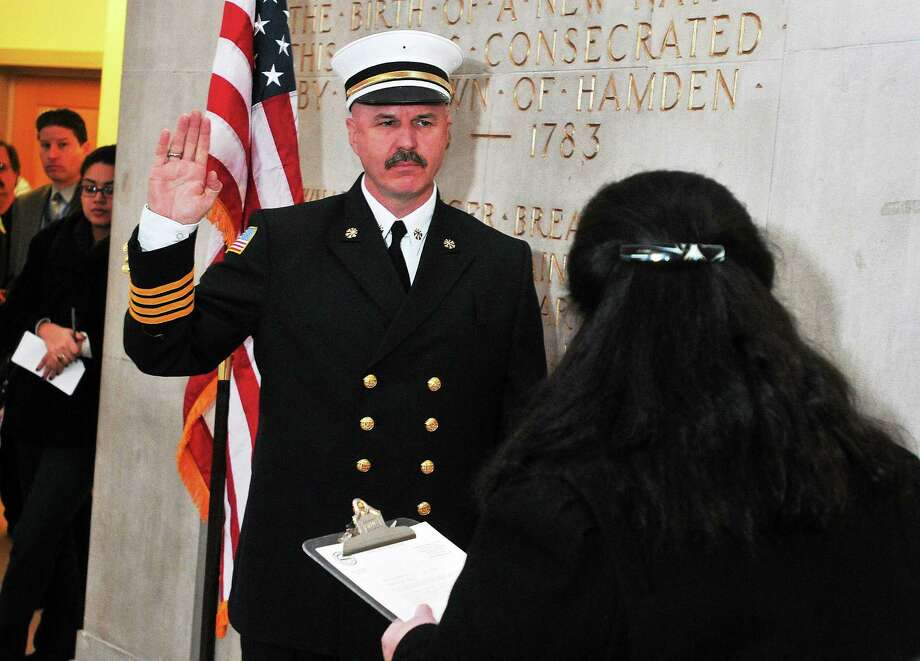 Gary Merwede sworn in to his post as deputy fire chief by Hamden Town Clerk Vera Morrison in this file photo. The department announced Friday that Merwede will serve as acting chief. Photo: Peter Casolino / File Photo