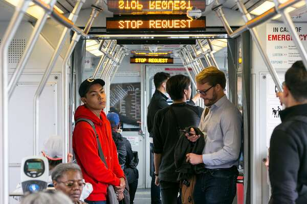 The Muni T line is known for the major issues that riders face including overcrowding, delays and the risk of car collisions because of left-hand turns. Riders take the light-rail on Wednesday, October 3, 2018 in San Francisco, Calif.
