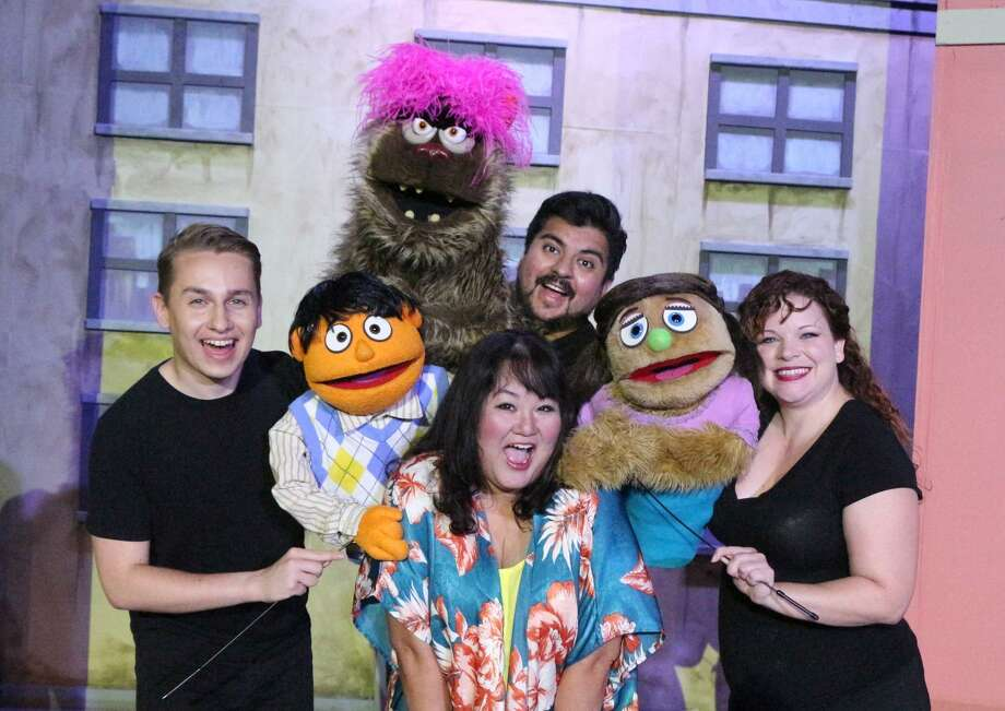 """Avenue Q"": Yep, those are puppets (not to mention actors Caleb Craig, clockwise from left, Isidro Medina, Morgan Clyde and Jen Harris). No, that most definitely does not mean that the Woodlawn Theatre's latest production is aimed at the whole family. ""Avenue Q"" is a wildly irreverent take on life after college, as the humans and puppets try to figure out adulthood. It includes lots of adult language and themes, puppet sex and a couple of characters dubbed the Bad Idea Bears.