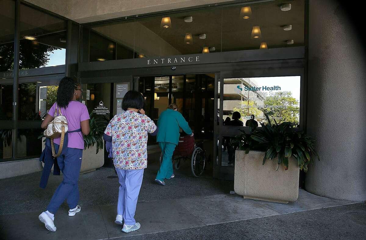 Staff walks through the main entrance of Sutter Health Alta Bates Summit medical center on Monday, June 27, 2016 in Berkeley, Calif.