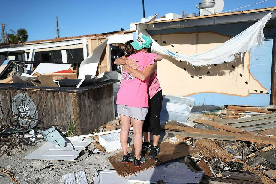 MEXICO BEACH, FL - OCTOBER 12: Monica Fabie is hugged by her friend Casey Whatler as she picks through what is left of her business after it was destroyed by hurricane Michael on October 12, 2018 in Mexico Beach, Florida. The hurricane hit the panhandle area with category 4 winds causing major damage. (Photo by Joe Raedle/Getty Images) Photo: Joe Raedle / Getty Images