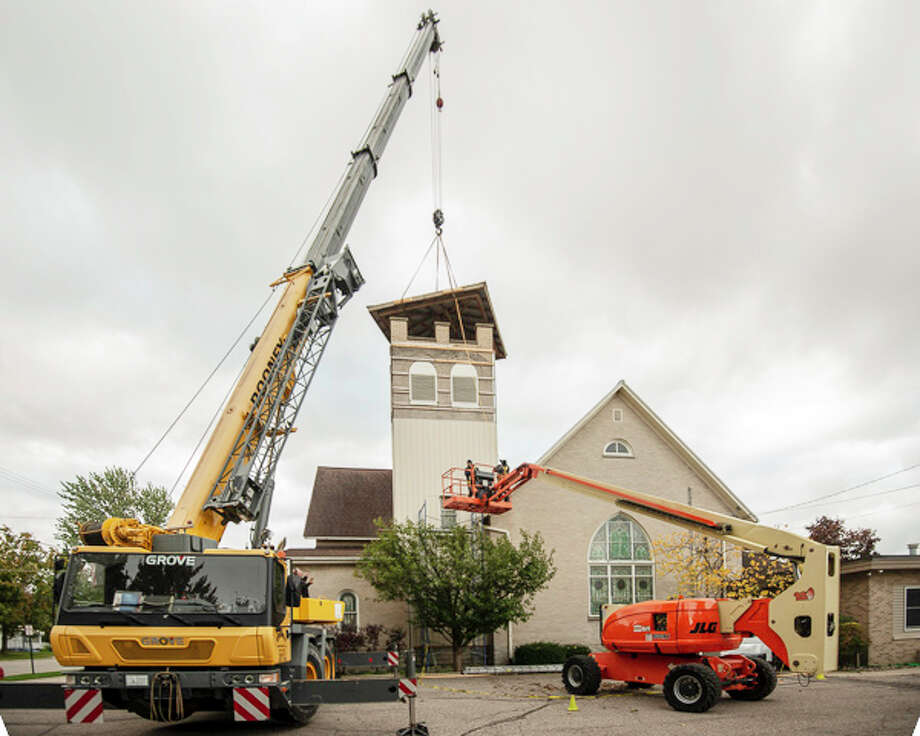 Construction crews were at Elkton United Methodist Church on Friday putting on a new steeple and rebuilding the church's bell tower. The project has been in the works for about a year and everything is on schedule to be completed this weekend. Photo: Photos Courtesy Of Fred Herrin