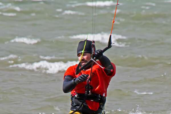 When the temperatures in the low 50's, and the winds howling, the natural thing to do is take to the waters of Saginaw Bay on a surf board attached to a parachute. That's exactly what a group of avid para surfers, aka, kite surfers, did recently. They were riding the waves and taking flight, some going 20 or 30 feet in the air before landing on the water again. The conditions seemed to be perfect for the endeavor, as the group surfed for hours along the shoreline of the beach in the Caseville County Park.