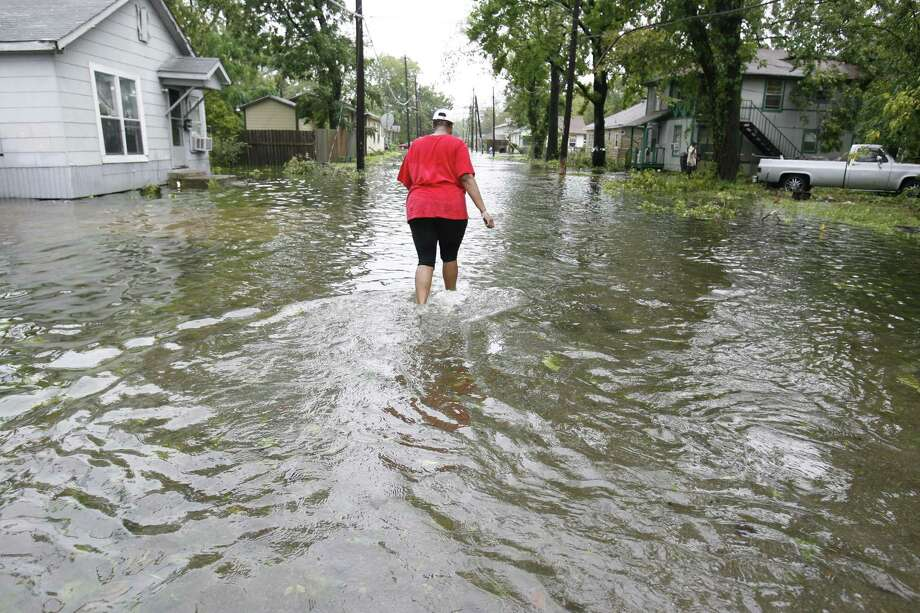 A resident walks a flooded street in the Independence Heights neighborhood north of 610, where flooding after heavy rains is common. Photo: Karen Warren, Staff / Houston Chronicle / Houston Chronicle