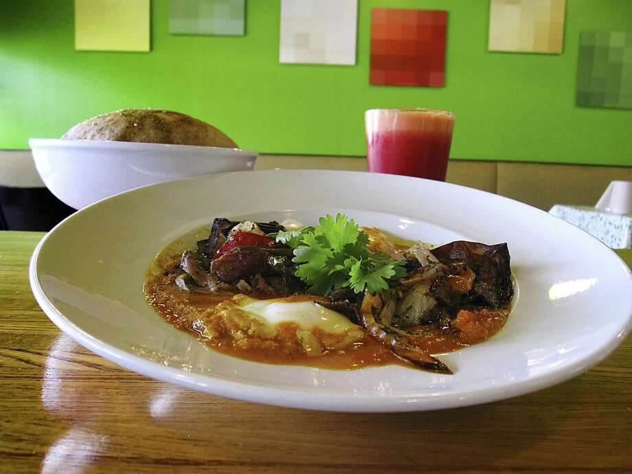 The new dinner menu at Moshe's Golden Falafel includes red shakshuka with tomatoes, eggplant, coddled eggs, peppers, onions and fresh pita. Photo: Mike Sutter /Staff